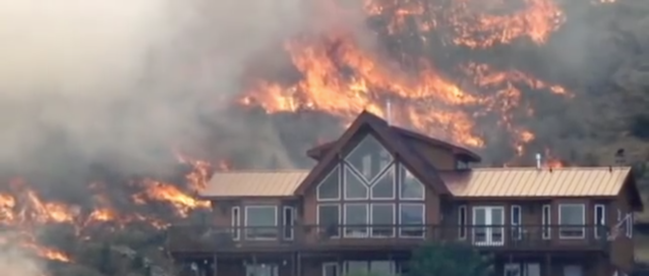 Wildfire around house with metal roof